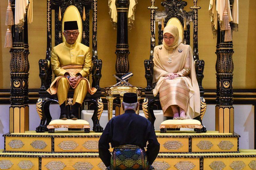 Sultan Abdullah Ibni Sultan Ahmad Shah and his consort Tunku Azizah Aminah Maimunah Iskandariah seated on their thrones during their coronation at the Istana Abu Bakar in Pekan, Pahang, yesterday.