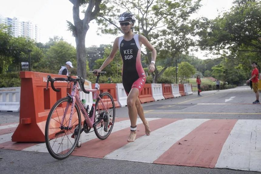 Triathlete Phoebe Kee transitioning from the cycling leg to the run during the Singapore International Triathlon 2017 National Championships at East Coast Park on Sept 10, 2017.