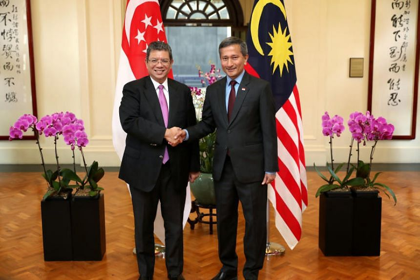 Foreign Minister Vivian Balakrishnan (right) and his Malaysian counterpart Saifuddin Abdullah at the Ministry of Foreign Affairs in Singapore on Jan 8, 2019.