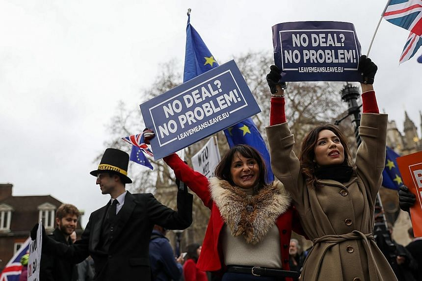 Pro-Brexit demonstrators near the Houses of Parliament in London on Tuesday. Members of the British expat community in Singapore expressed concern over the uncertain path ahead for their country after British Prime Minister Theresa May's Brexit deal