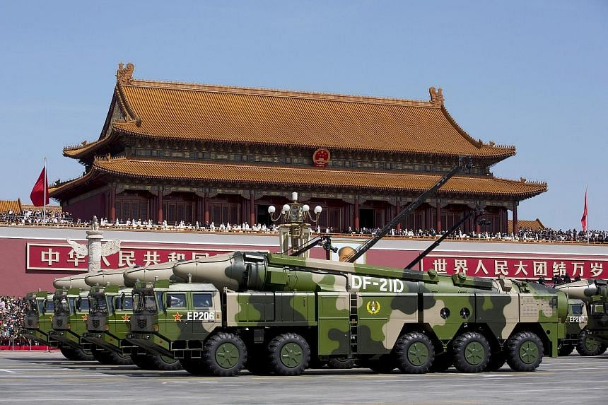 Chinese military vehicles carrying DF-21D anti-ship ballistic missiles at a 2015 military parade in Beijing. The US Defence Intelligence Agency's report comes amid heightened trade tensions between Washington and Beijing, and continuing disputes abou
