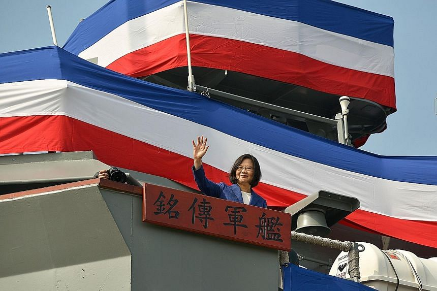 Taiwan's President Tsai Ing-wen waving from the deck of the Ming Chuan frigate during a ceremony to commission two guided missile frigates from the US for the Taiwan navy last November.