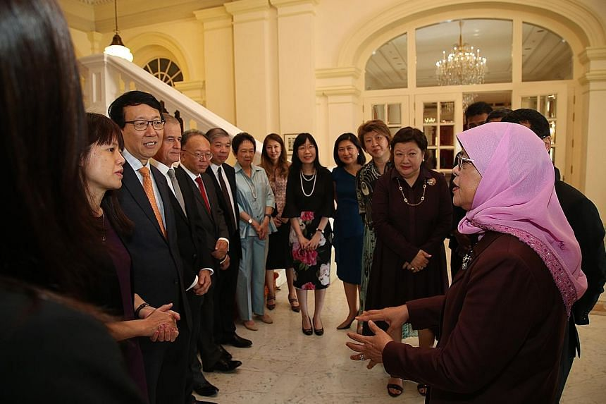 President Halimah Yacob meeting members of the Council for Board Diversity at the Istana yesterday. Madam Halimah is patron of the council, which is co-chaired by National Volunteer and Philanthropy Centre chairman Mildred Tan (second from right) and