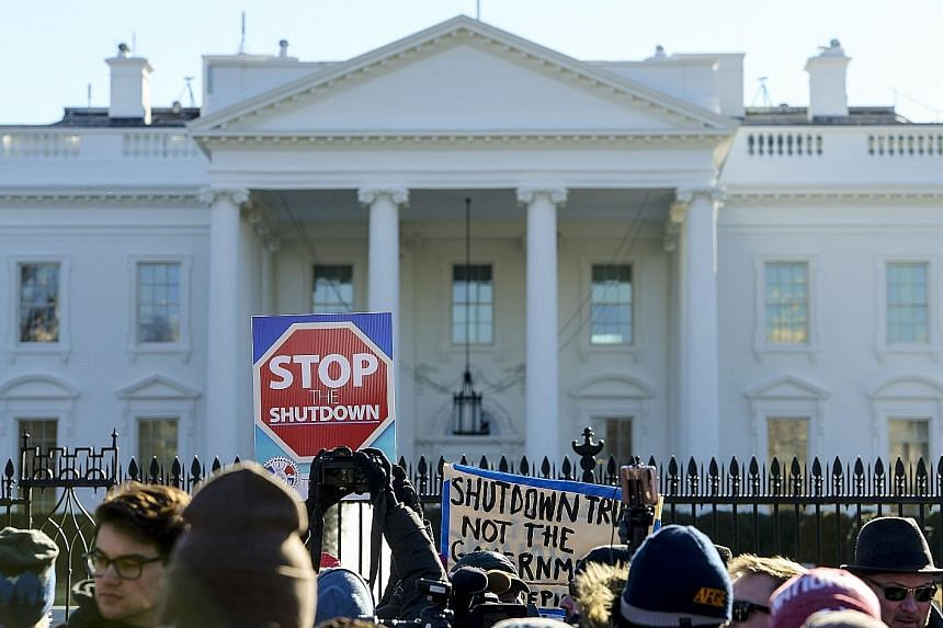Federal workers, contractors and supporters rallying outside the White House last week to demand that President Donald Trump and the Senate end the partial shutdown.