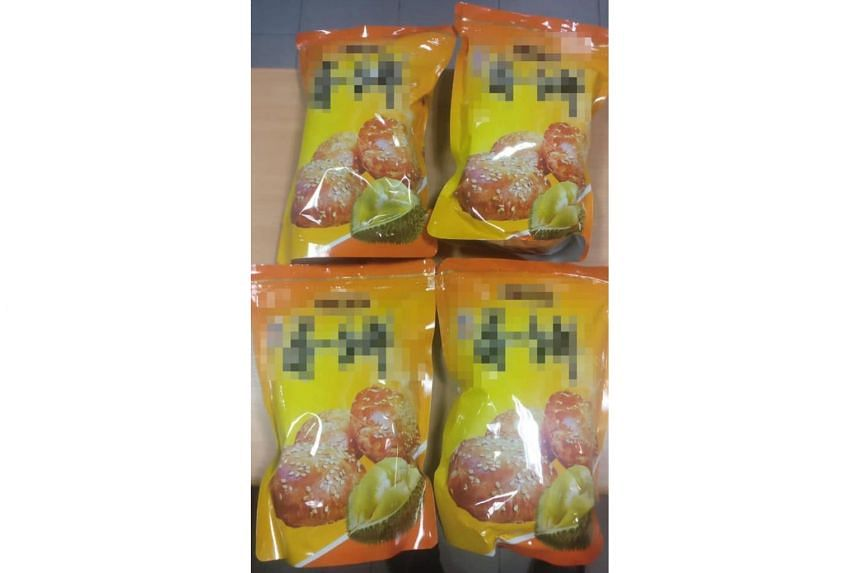 Four of the packets of durian cookies, which were used by the smugglers in a bid to conceal their bak kwa.