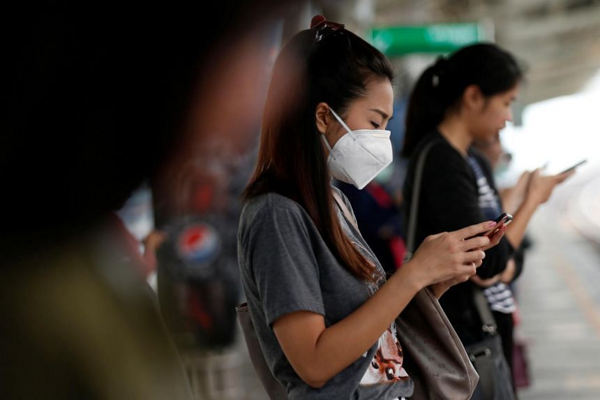 A woman wears a mask as she commutes to work, in Bangkok, Thailand on Jan 16, 2019.