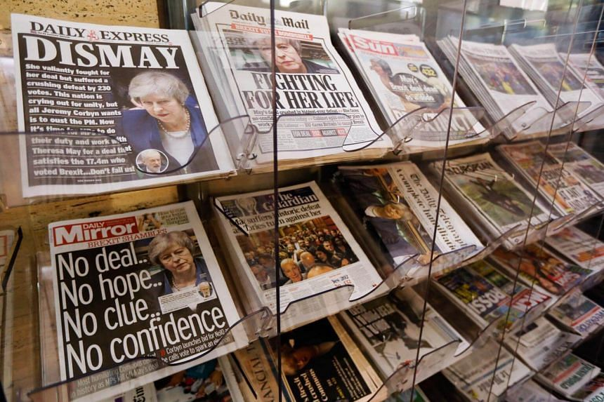 Daily papers said British PM Theresa May's deal was sunk after the huge vote against the agreement struck between Mrs May's government and Brussels.