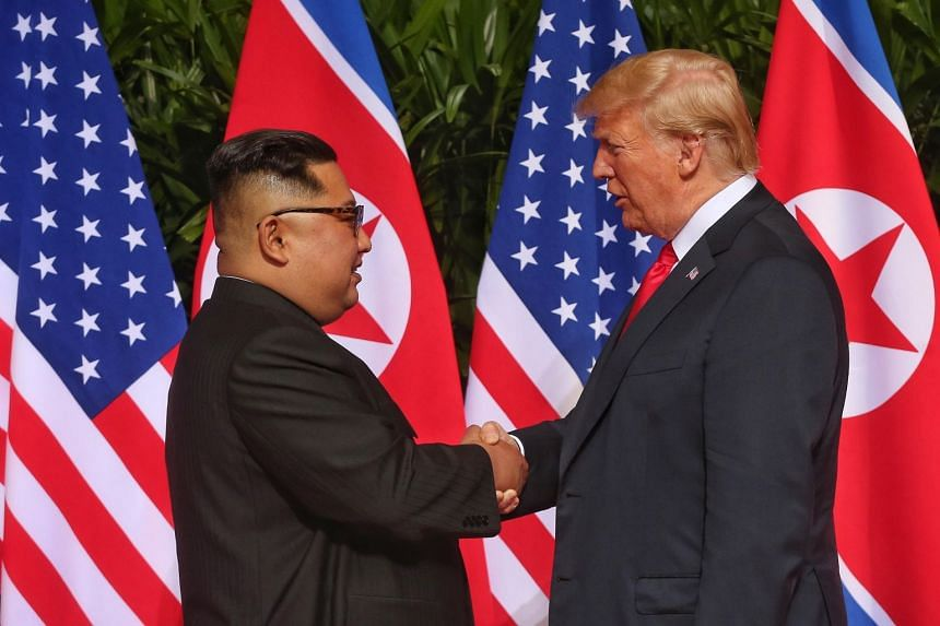 US President Donald Trump and North Korean leader Kim Jong Un  at their historic summit at the Capella Hotel on Sentosa in Singapore on June 11, 2018.