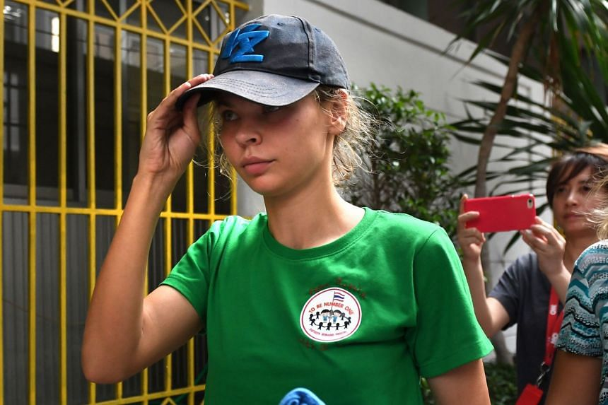 Belarusian model Anastasia Vashukevich arrives at the Thai immigration department in Bangkok on Jan 17, 2019, during her deportation together with other associates after pleading guilty in court to multiple charges.