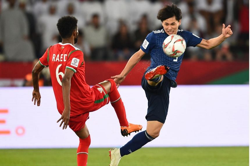 Minamino Takumi (right) Japan in action against Raed Saleh of Oman during the 2019 AFC Asian Cup group F preliminary round match between Oman and Japan in Abu Dhabi, United Arab Emirates, on Jan 13, 2019.