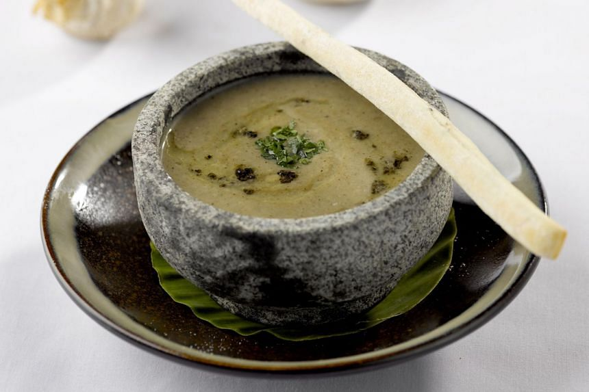 Mushroom Truffle Bisque Served In Stone Pot from LingZhi Vegetarian restaurant.