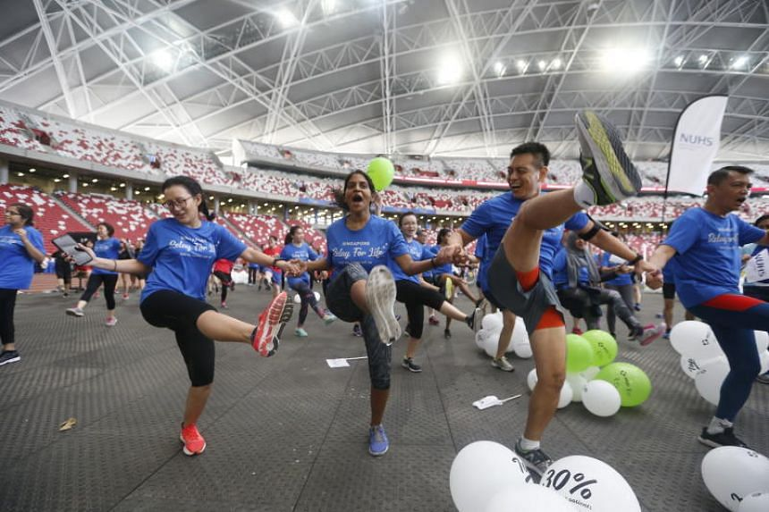 Participants in a mass dance workout after the TalkMed Relay For Life 2018 at the Singapore Sports Hub on March 11, 2018.