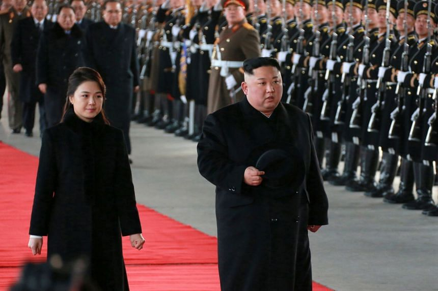 North Korean leader Kim Jong Un and his wife Ri Sol-ju reviewing a guard of honour as he leaves for China from Pyongyang, on Jan 7, 2019.