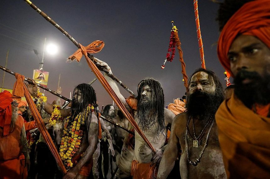 Hindu holy men arriving to take a dip during the first grand bath of the Kumbh Mela in Prayagraj, India, on Tuesday.