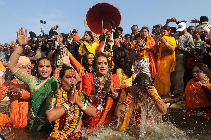 Transgender ascetics taking a holy bath on Tuesday at the confluence of the Ganga, Yamuna and mythical Saraswati rivers during the Kumbh Mela festival in Allahabad in India's Uttar Pradesh state.