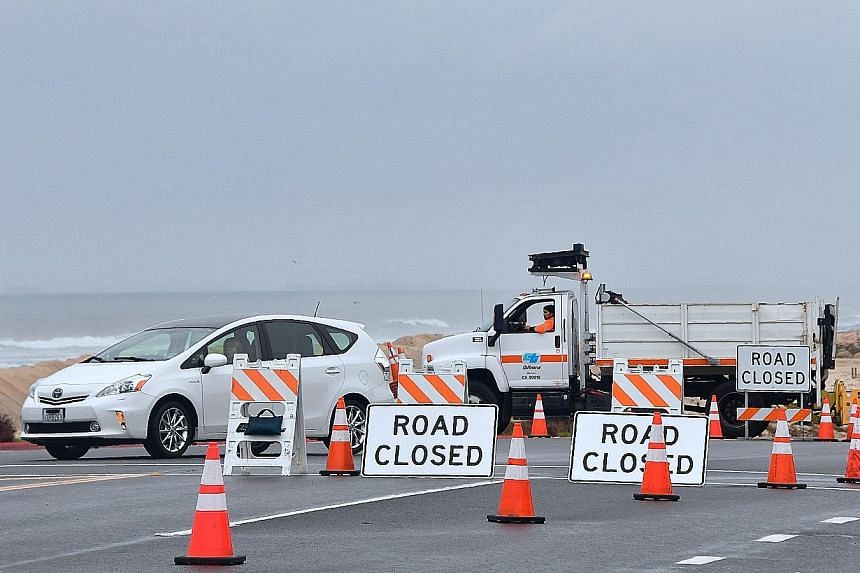 Vehicles being diverted on the Pacific Coast Highway as southern California faced another storm early on Wednesday, with rainfall expected to get heavier later into the day.