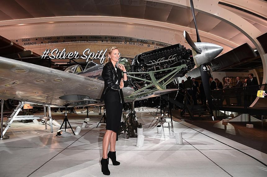 Ulysse Nardin worked with Italian artist Milo Manara to create handpainted timepieces telling the story of a woman who finds love with a mermaid. Model Karolina Kurkova at IWC's launch of its new pilot's watches at the Salon International de la Haute