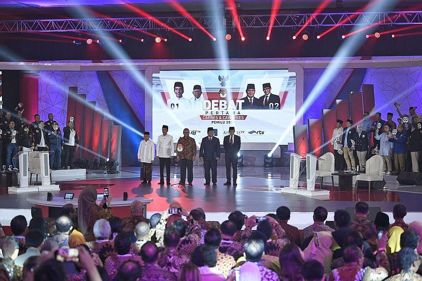 Taking centre stage at the first debate for Indonesia's 2019 presidential election were General Elections Commission chairman Arief Budiman (centre) with (from far left) vice-presidential candidate Ma'ruf Amin and incumbent President Joko Widodo, alo