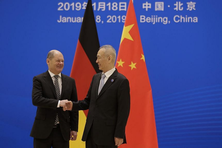 German Finance Minister Olaf Scholz (left) with Chinese Vice Premier Liu He at the Diaoyutai State Guesthouse in Beijing, China on Jan 18, 2019.