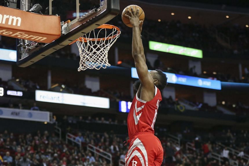 Houston Rockets guard James Harden dunks the ball during the second quarter against the Memphis Grizzlies at Toyota Center.