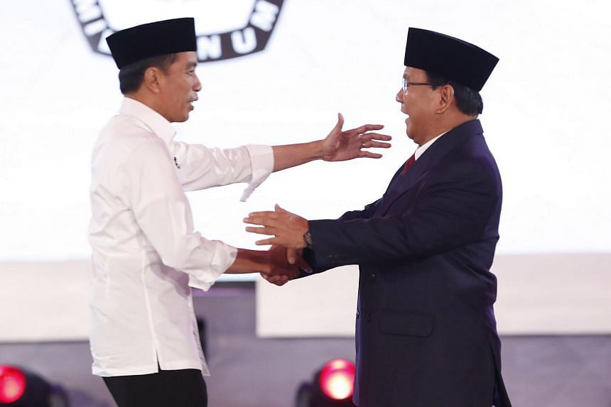 Incumbent President Joko Widodo (left) with challenger Prabowo Subianto during a debate among candidates in Jakarta, Indonesia on Jan 17, 2019.
