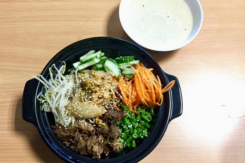 "The bibimbap has a generous portion of brown rice topped with thinly sliced carrots, bean sprouts, chopped long beans, sliced cucumber and kimchi. The fragrant ""meat"" in the dish is made from mushrooms."