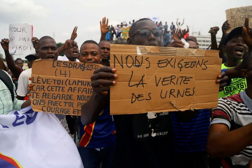 Supporters of Mr Martin Fayulu, runner-up in Democratic Republic of Congo's presidential election, chant slogans as he delivers his appeal contesting the Congo's National Independent Electoral Commission results of the presidential election at the co