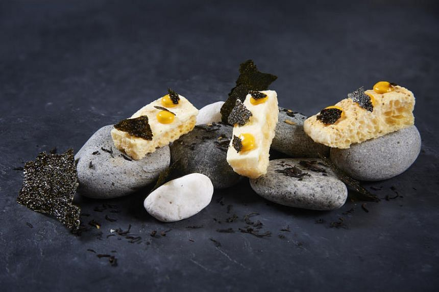 Head chef Emanuele Faggi of Zafferano Italian Restaurant & Lounge at Ocean Financial Centre dries the rind of parmesan cheese and tops it with uni cream and nori flakes to serve as a starter in the restaurant.