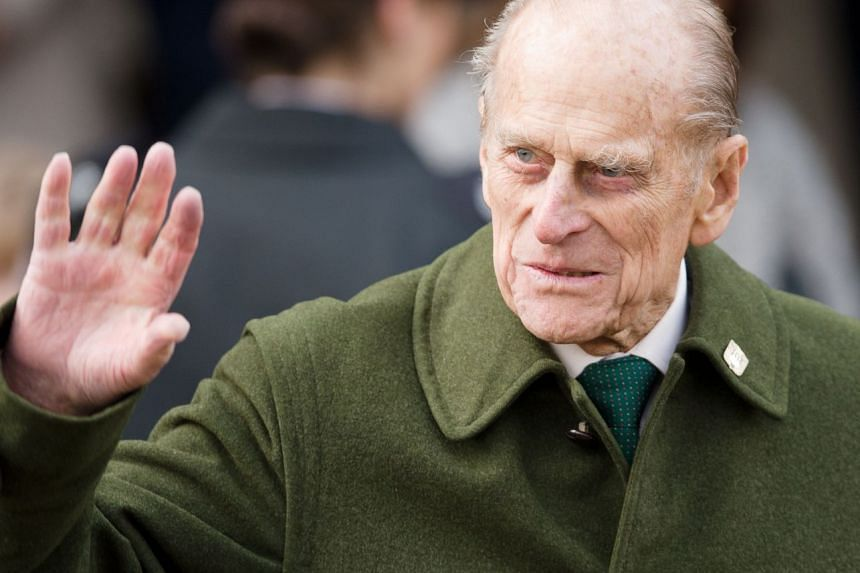 Britain's Prince Philip, Duke of Edinburgh, waves to well-wishers after the Royal family Christmas Day church service at St Mary Magdalene Church in Sandringham, Norfolk, in the east of England, on Dec 25, 2012.