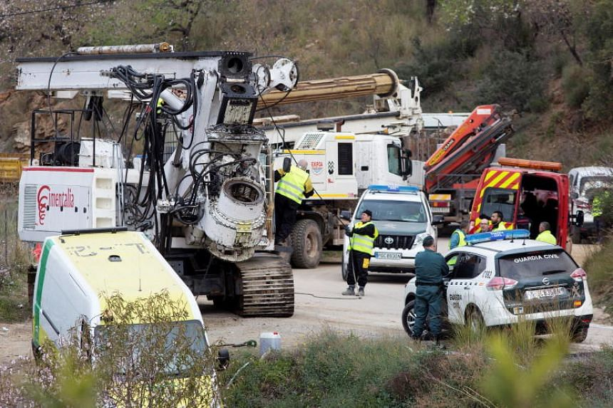 Heavy machinery arrive at the place where rescue teams are working to find the two-year-old Julen, who has been trapped inside a 110-meters-well since Jan 13, in Totalan, Malaga, on Jan 18, 2019.