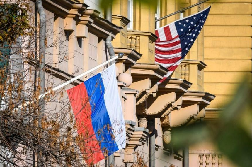 A Russian flag flies next to the US embassy building in Moscow on Oct 22, 2018.