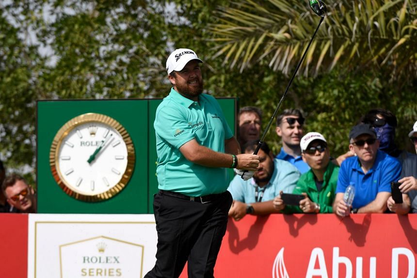 Lowry looks on after playing a shot during day three of the Abu Dhabi Golf Championship.