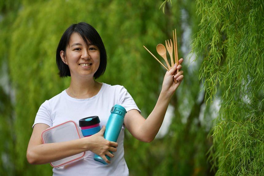 Ms Khee Shihui, 36, with the daily utensils she brings around with her when she goes out.