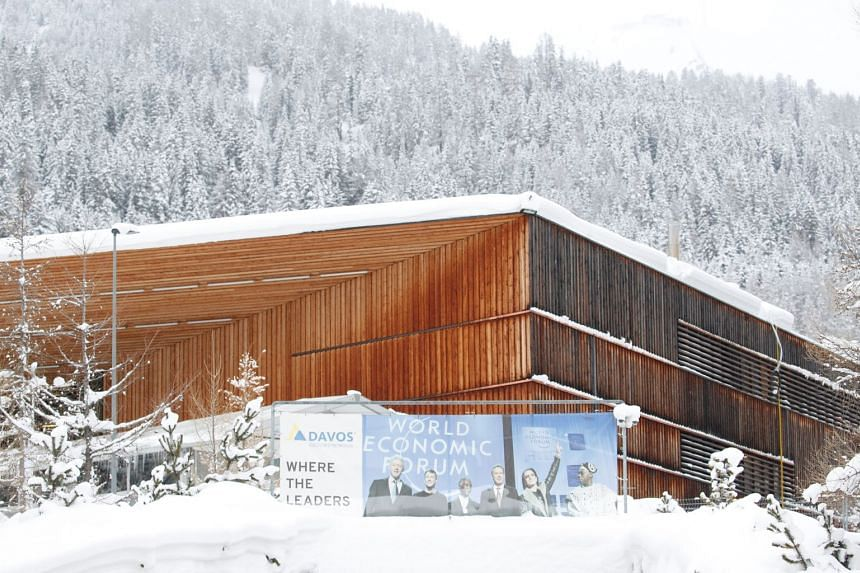The World Economic Forum (WEF) banner is seen in front of the congress centre in Davos, Switzerland.