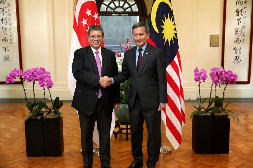 Singapore's Foreign Minister Vivian Balakrishnan (right) met with Malaysia's Foreign Minister Saifuddin Abdullah, on Jan 8, 2019.
