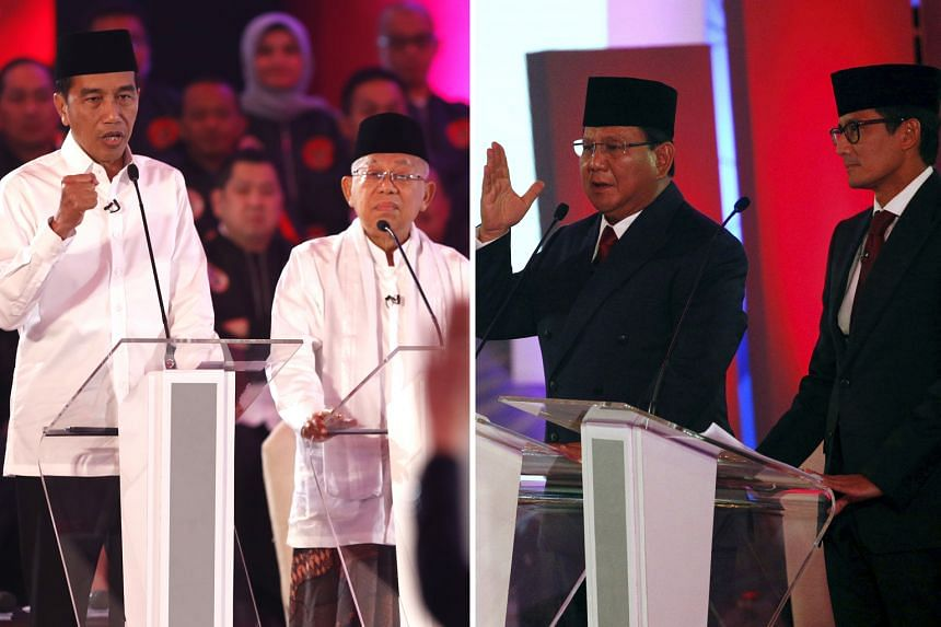 Incumbent President Joko Widodo and his running mate Ma'ruf Amin (left) exchanged verbal punches with challengers Prabowo Subianto and his running mate Sandiaga Uno - during the televised debate yesterday, which was broadcast live by 18 television an