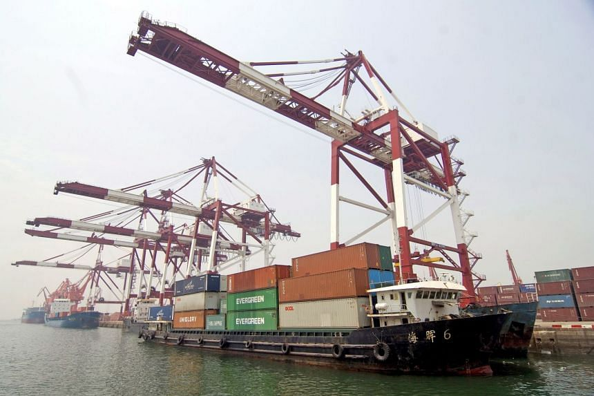 Container vessels are loaded with cargo at the Port of Qingdao, in eastern China's Shandong province.