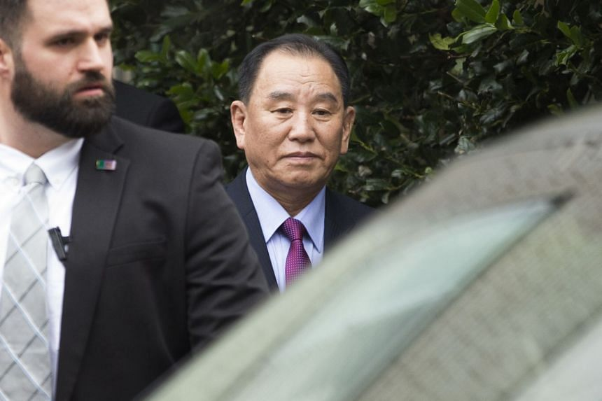 Kim Yong Chol (centre) departs a hotel after participating in a meeting there with US Secretary of State Mike Pompeo (unseen).