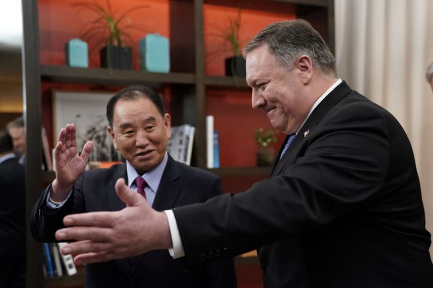 Mike Pompeo escorts Kim Yong Chol into talks .