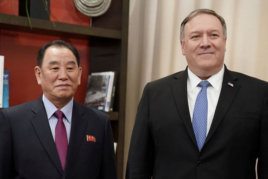 Mike Pompeo poses with Kim Yong Chol as they start talks aimed at clearing the way for a second US-North Korea summit.