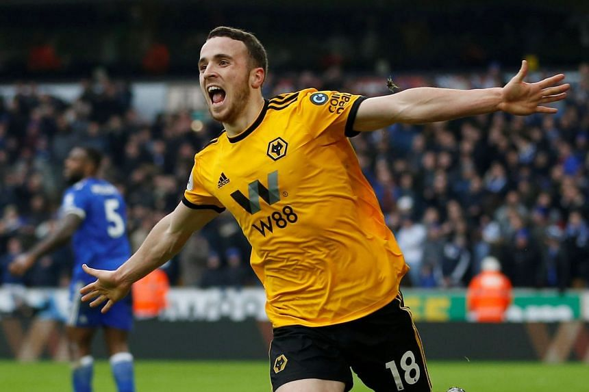 Jota celebrates scoring Wolves' fourth goal to complete his hat-trick.