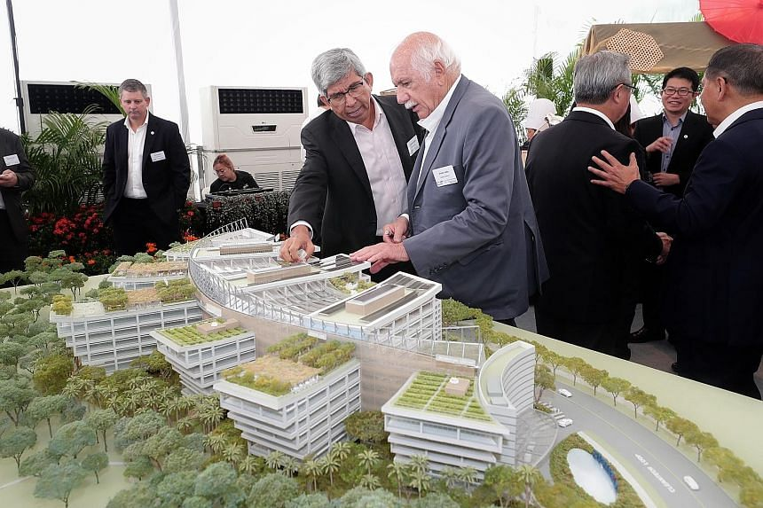 Professor Yaacob Ibrahim (centre), adviser to the president of the Singapore Institute of Technology, and Safdie Architects' Mr Moshe Safdie discussing the design of Surbana Jurong Campus at yesterday's ground-breaking event. The campus' location in