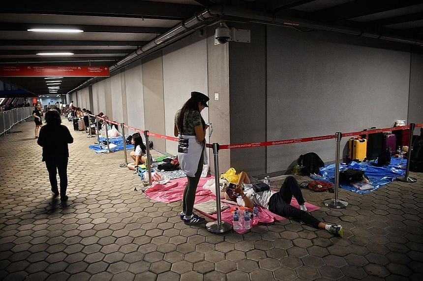 The queue yesterday at the National Stadium, where K-pop boyband BTS is holding its concert, scheduled to take place at 7pm today. Some fans do not even have a concert ticket, but are in the queue to buy merchandise. The first person in line started