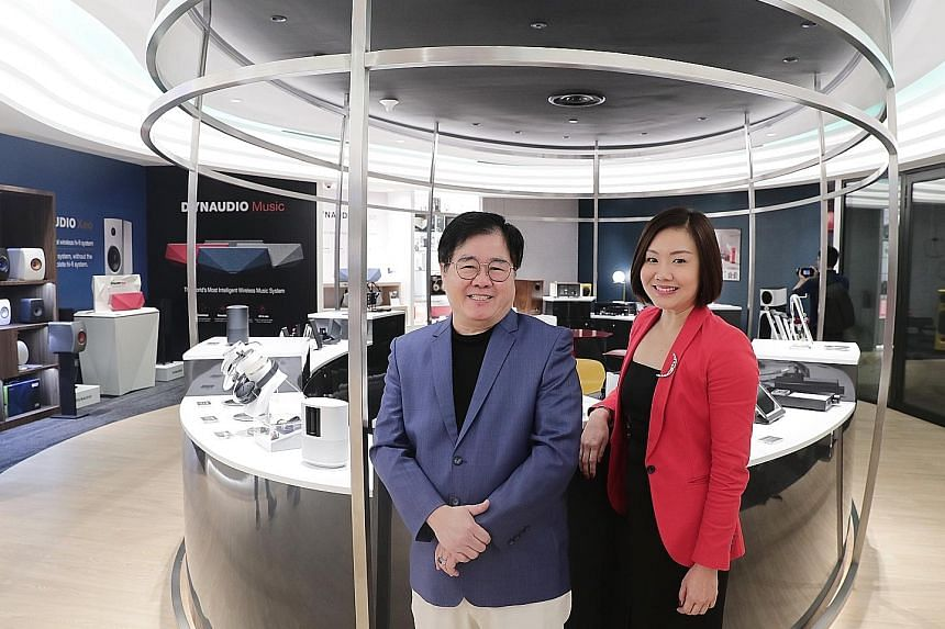 Challenger Technologies CEO Loo Leong Thye and chief marketing officer Loo Pei Fen at Musica Boutique, which has a soundproof room where listeners can compare products.