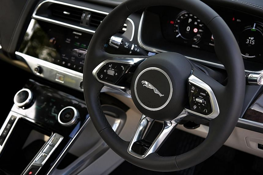 The Jaguar I-Pace's low centre of gravity, wide tracks, all-wheel-drive and battery bank make it a natural around bends. Its ultra-chic cockpit has push buttons galore and a super slim dashtop.