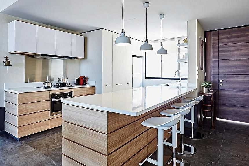 (Above) With the removal of a kitchen wall, more natural light is let into the apartment. (Left) Wood-like tiles re-create the feel of a wooden bath. The balcony gets an update with new textured paint on parapet walls and timber decking over the orig