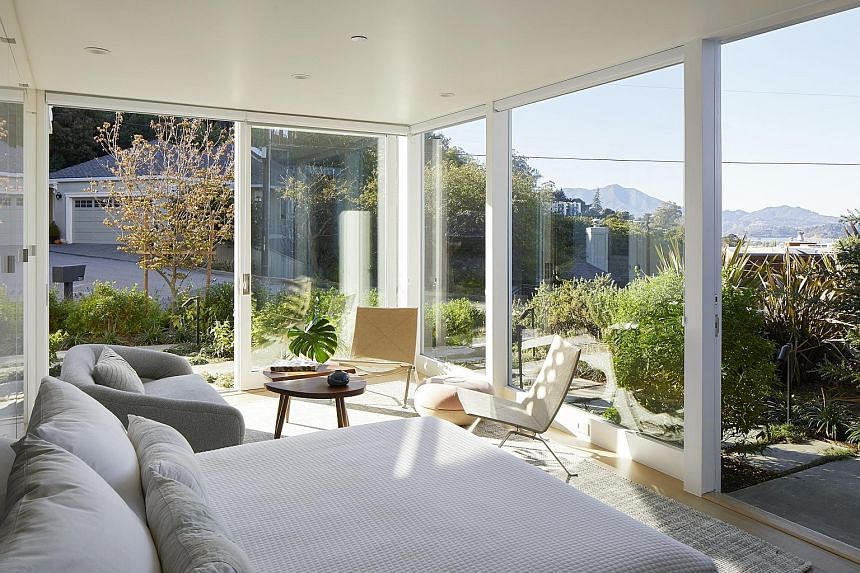 After the renovation, the house has floor-to-ceiling bay views (above) and an accessory dwelling unit (below) on the lower level.
