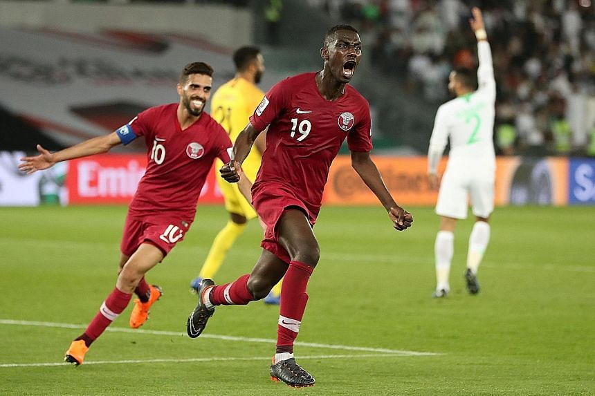 Qatar's Almoez Ali celebrating with Hassan Al-Haydos after scoring his team's goal in the 2-0 Asian Cup win over Saudi Arabia on Thursday. The Qataris will next face 2007 champions Iraq in the last 16 while the Saudis will take on 2011 winners Japan.