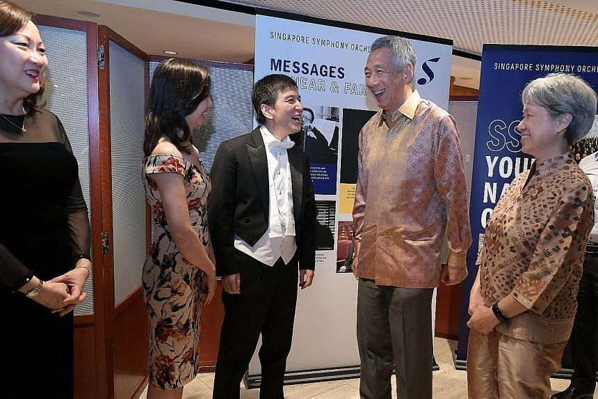 Prime Minister Lee Hsien Loong and Mrs Lee chatting with Singapore Symphony Orchestra music director Lan Shui and his wife Liu Lin Lin at the Esplanade last night. With them is SSO founding member Lynnette Seah.