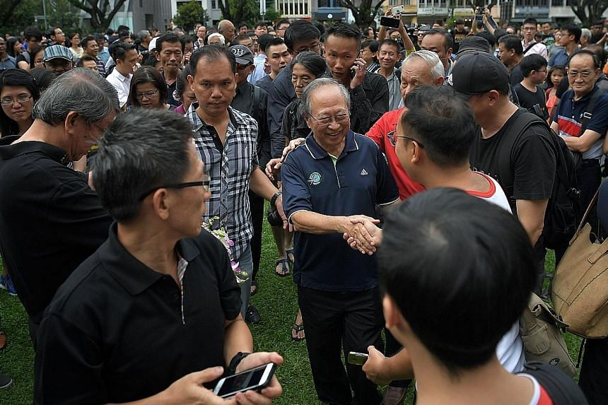 """Dr Tan Cheng Bock greeting supporters at a 2017 event. Dr Tan, a six-term MP who retired from politics in 2006, applied to register his Progress Singapore Party on Wednesday. He said it comprises 11 other """"like-minded Singaporeans""""."""